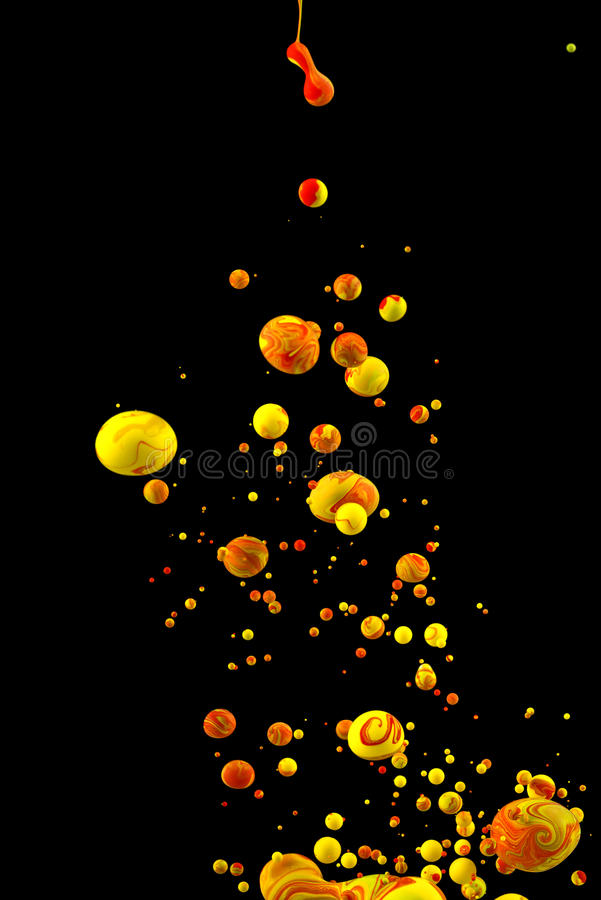 Liquid color drop on black background stock photo