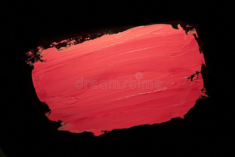 Coral red orange lipstick background texture smudge samples royalty free stock photo