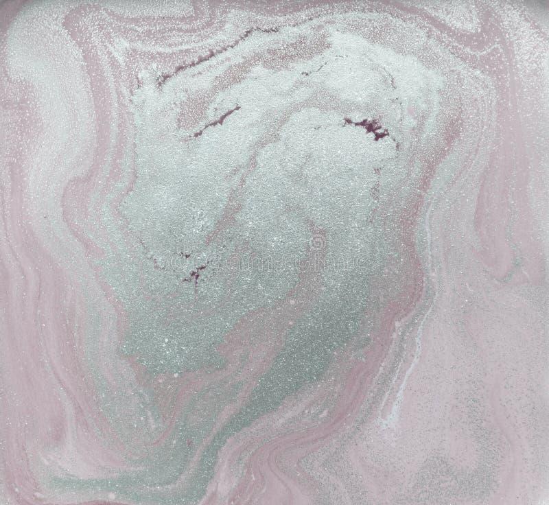 Liquid gold marbled pattern. Pale pink background. Golden powder stock photos