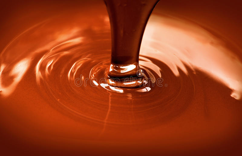 Liquid hot chocolate pouring royalty free stock photo