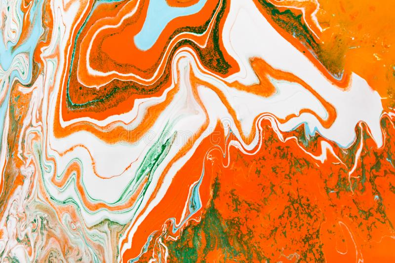 Liquid marbling acrylic paint background. Fluid painting abstract stock photo