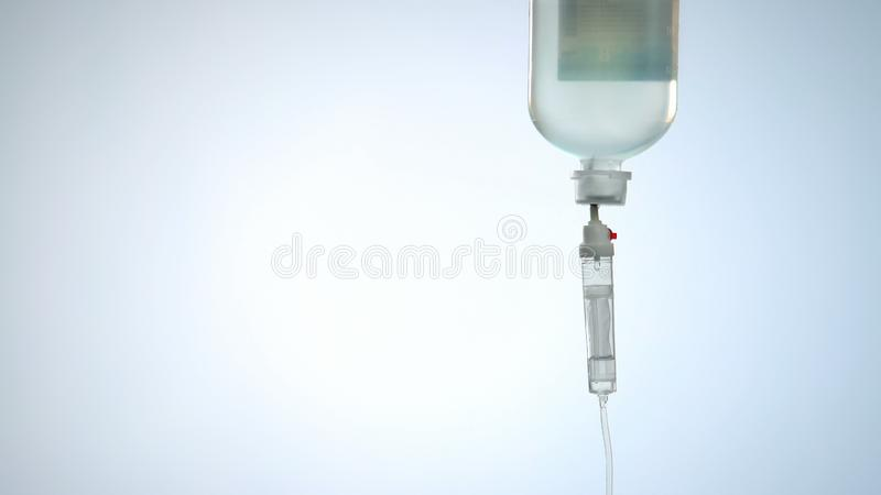 Liquid medicine in intravenous drip bag and line, therapy for urgent life saving stock image