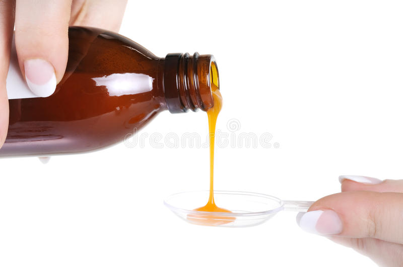 Liquid medicine pouring royalty free stock images