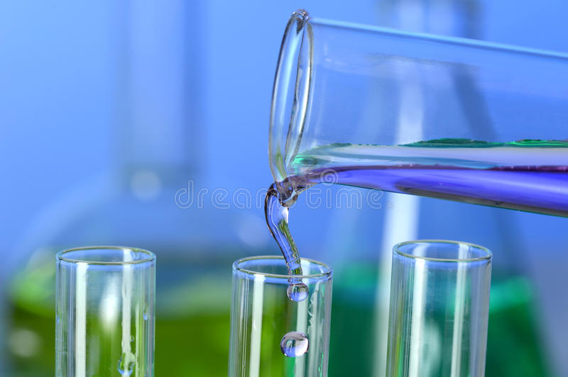 Liquid Pouring into Test Tube royalty free stock photo
