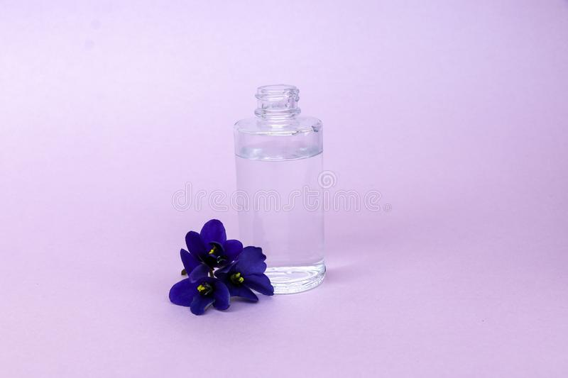 Liquid in  transparent bottle with pipette for soaring electronic cigarettes with  scent and taste of flowers, on  pink background stock images