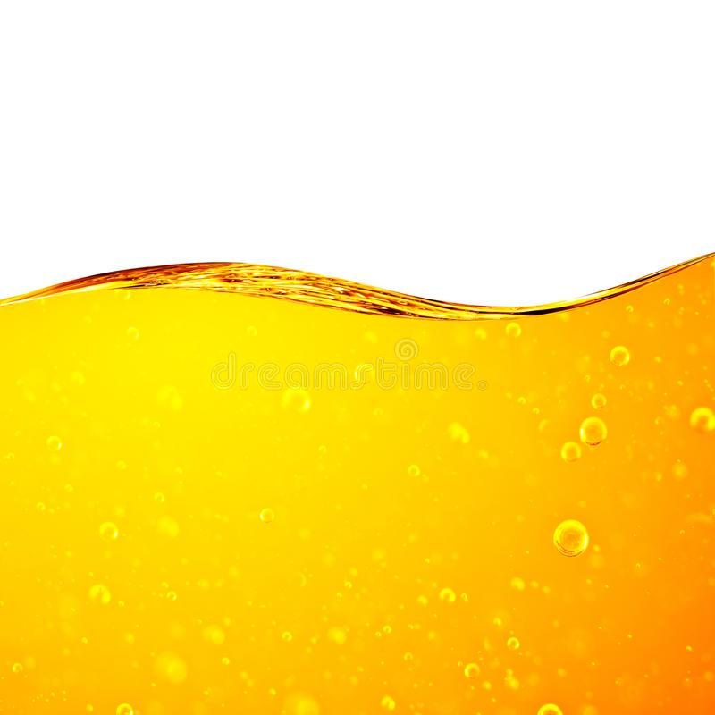 Liquid yellow wave line. Gold bubbles of air. royalty free stock images