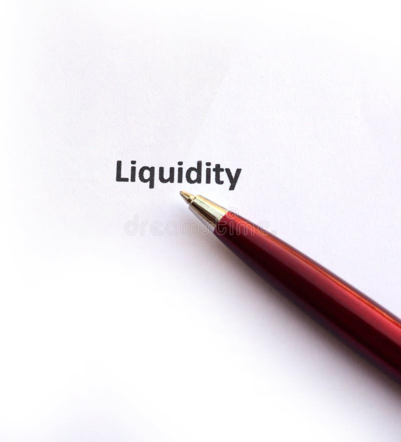 Liquidité avec le stylo images stock