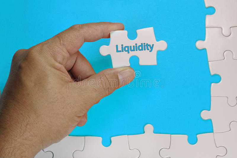 Liquidity Text - Business Concept. Liquidity word on white puzzle - Business Concept stock photos
