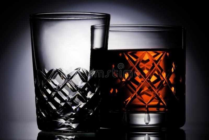 Liquor. Glass of liquor and backlight royalty free stock image