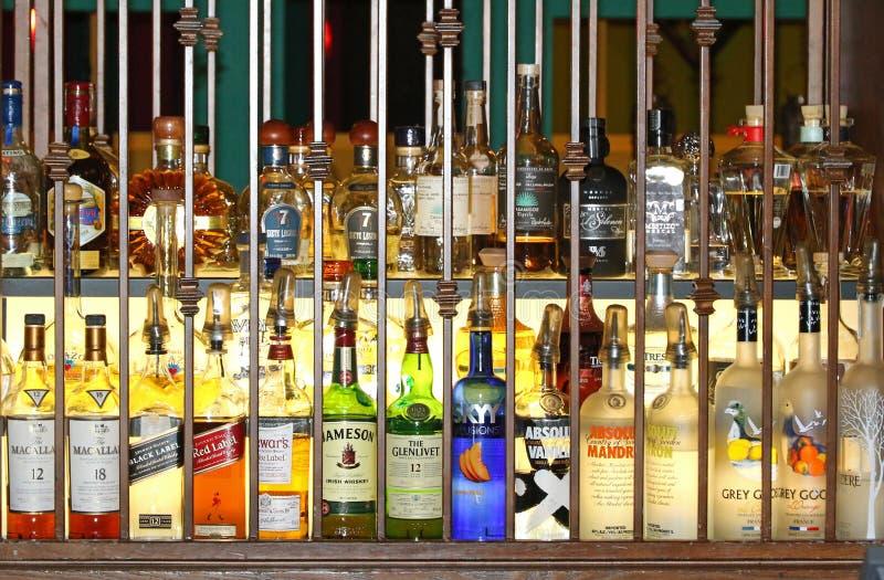 Liquor bottles behind bars royalty free stock photos