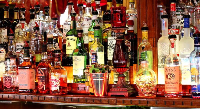 Liquor bottles behind a bar. royalty free stock photography