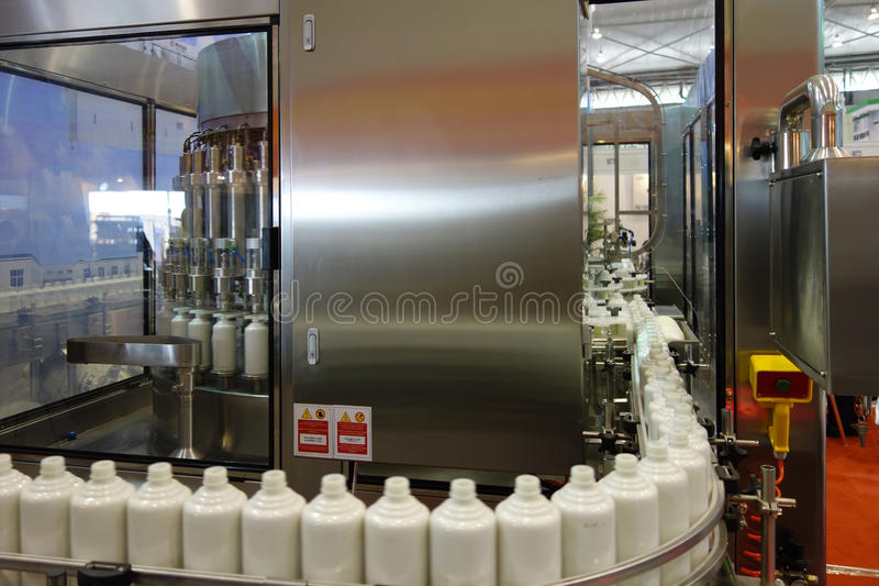 Liquor filling machine. In factory stock photography