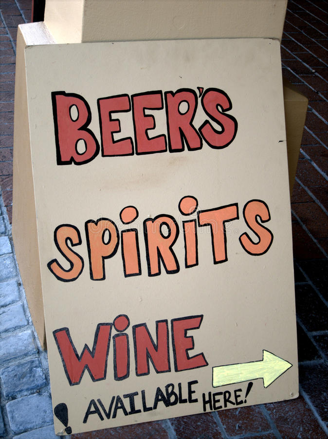 Liquor store sign. Pointing way to beers, spirits and wine stock photos