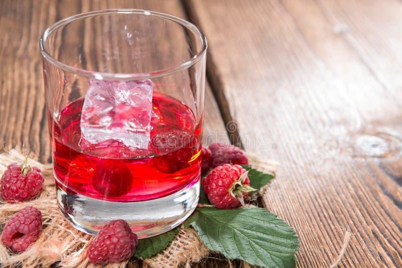 Liquore casalingo del lampone immagine stock