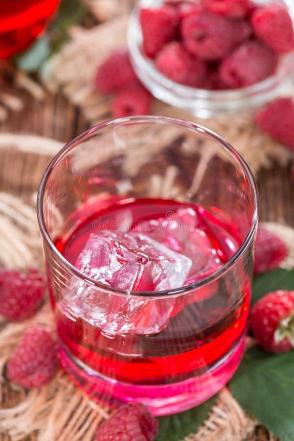 Liquore casalingo del lampone immagini stock