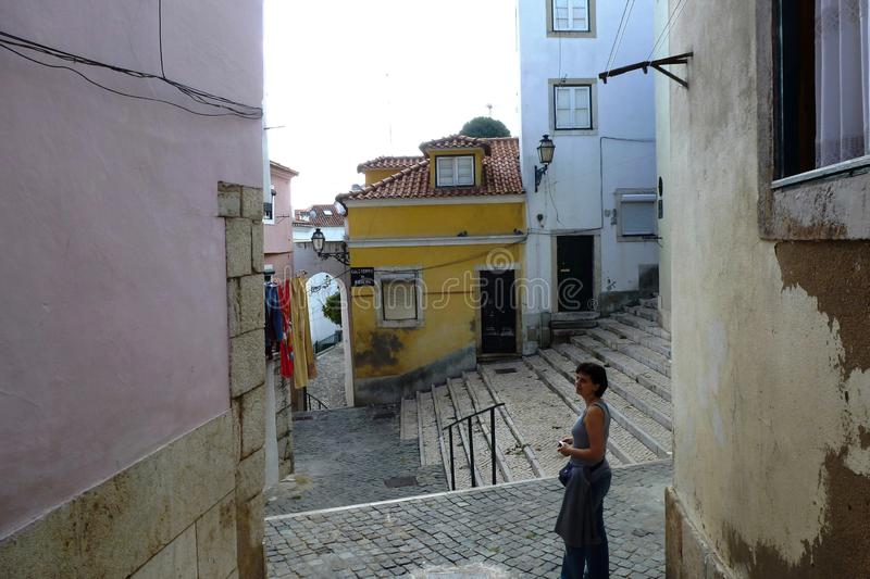 Lisbon, Alfama district. drying clothes hanging out to dry on washing line at a street corner on washday royalty free stock image