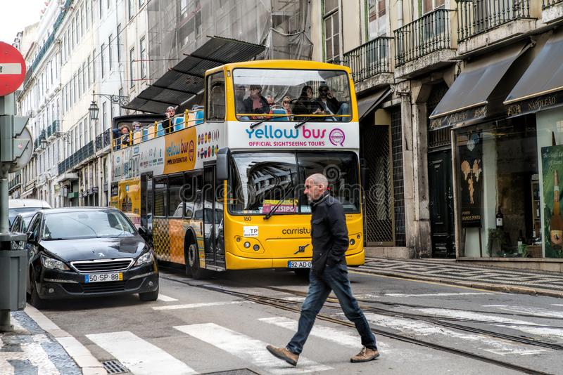 The Lisbon sightseeing bus tour in Lisbon, Portugal. The Lisbon bus tour is popular service for tourists royalty free stock images