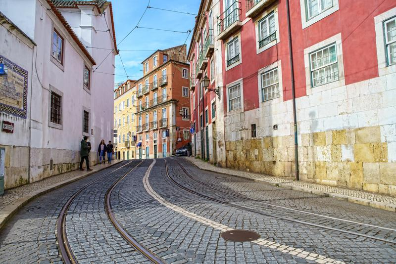 People exploring the narrow streets of Alfama in Lisbon stock photography