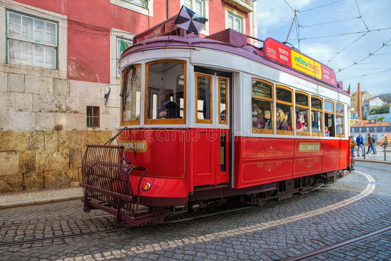 Public tram on the streets of the Alfama neighbourhood, the old quarter of Lisbon, Portugal royalty free stock images