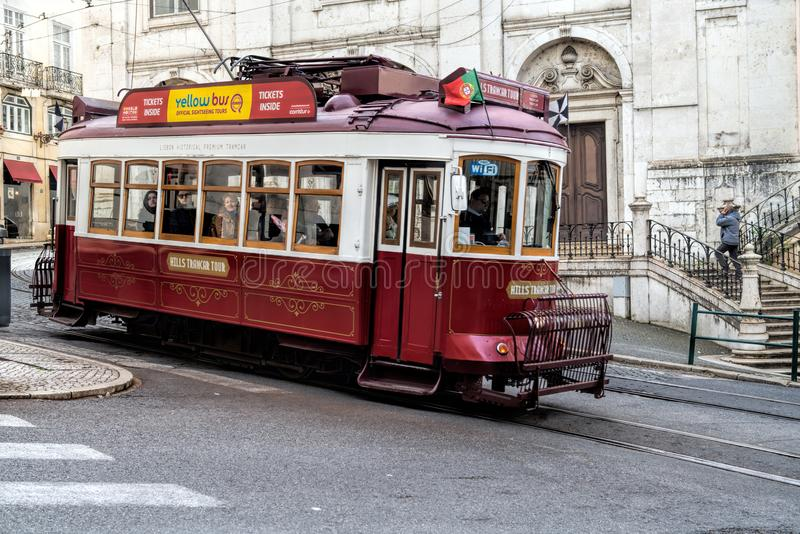 Touristic electric tram in a street of downtown Lisbon, Portugal royalty free stock images