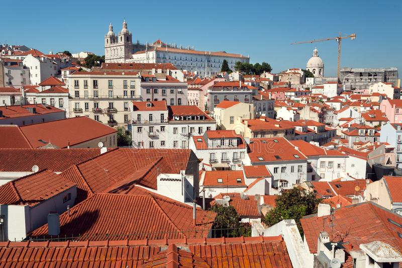 Lisbon cityscape with old tile roofs of historical city streets. Lisbon view cityscape with old tile roofs of the historical city streets stock images