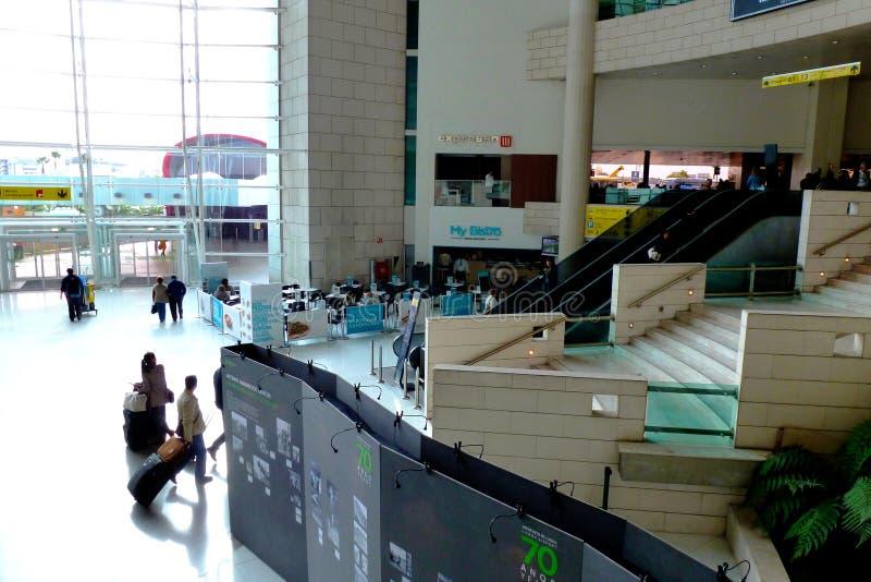 Lisbon, International Airport interior grand interior and passengers. Lisbon, Portugal: soft background of International Airport interior with wide, impressive stock photos