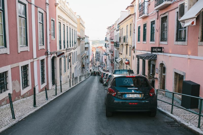 Lisbon, may 1, 2018: an Ordinary city street with residential buildings. Normal life in Europe. Car parking stock photography