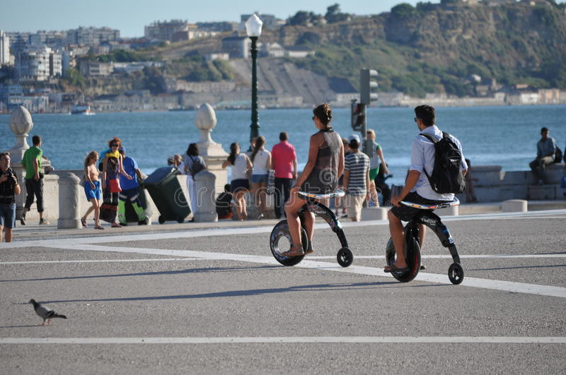 Lisbon Outdoor 2. People on the electrical bikes. Harbour of Lisbon stock photography