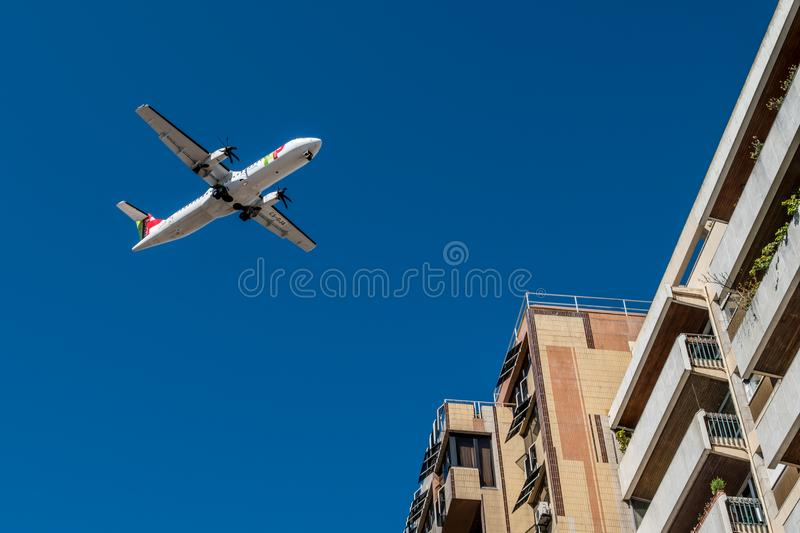 LISBON, PORTUGAL - APRIL 18, 2018: Tap Air Portugal plane in the. Air over Lisbon royalty free stock photos