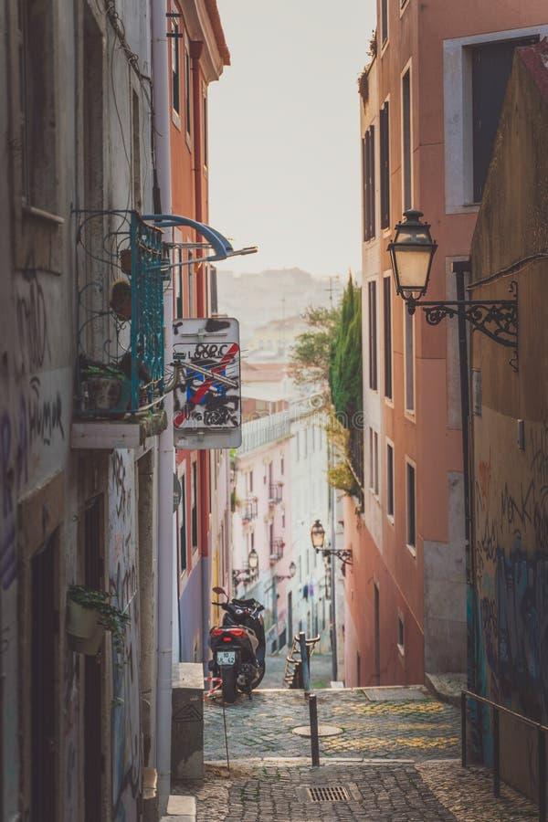Lisbon, Portugal - 01/03/19: Beautiful narrow street, motor bike stock photography
