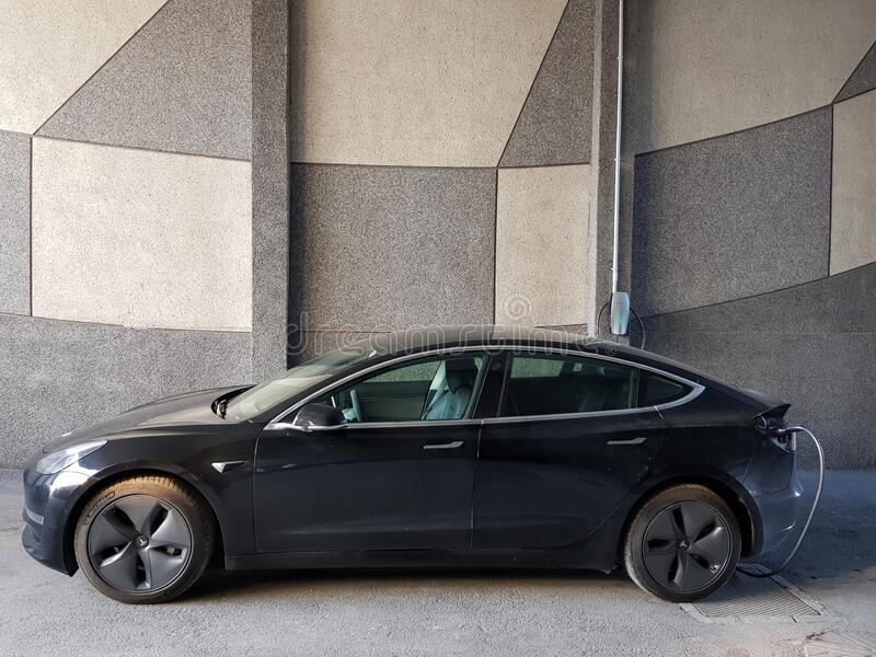 Tesla Car Charging The Electric Battery With Portable Wall ...