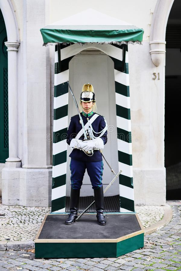 Lisbon, Portugal - December 12, 2018: Museu Guarda Nacional Republicana entrance with guard holding a sword, dressed in stock photography