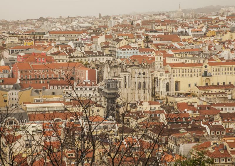 Lisbon, Portugal, Europe - houses of the old town and the Santa Justa Lift. This image shows a view of Lisbon, Portugal, Europe. We can see the old town and the royalty free stock photo