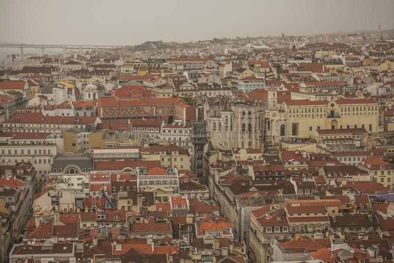 Lisbon, Portugal, Europe - the old town and the Santa Justa Lift and the 25 de Abril Bridge. This image shows a view of Lisbon, Portugal, Europe. We can see the stock images