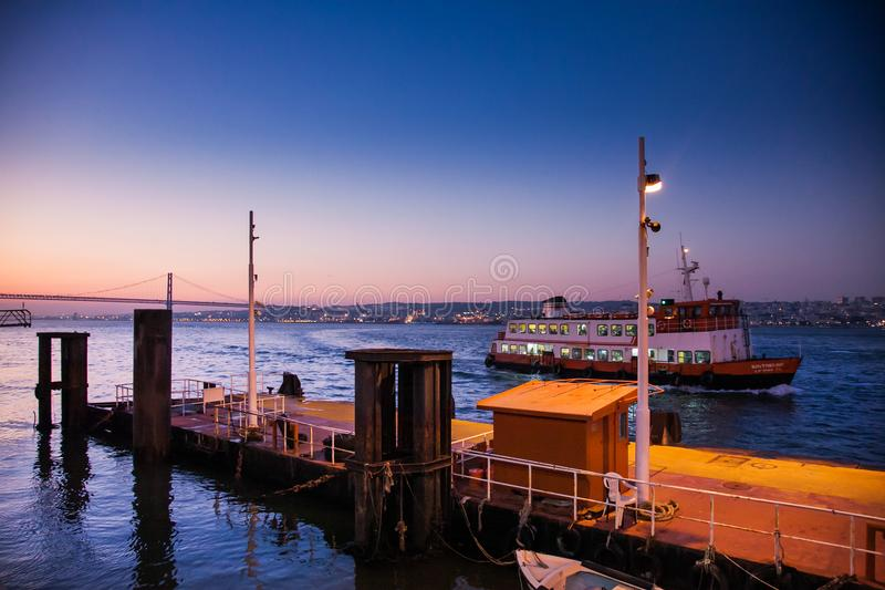 LISBON, PORTUGAL - February 01, 2011: The Tagus River past the 2 royalty free stock photography