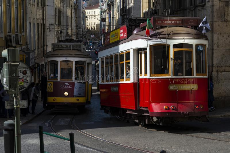 Traditional trams in a street of the Baixa neighbourhood, in the city of Lisbon stock photos