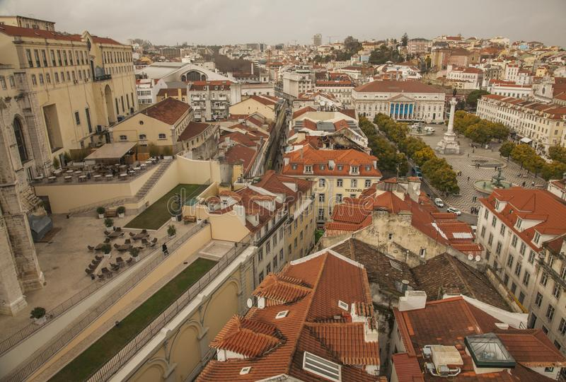 Lisbon, Portugal - the houses of the old town seen from the Santa Justa Lift. This image shows a view of Lisbon, Portugal, Europe. We can see the red roofs of royalty free stock images