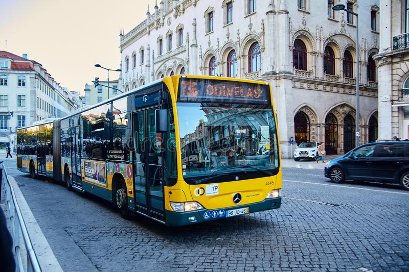 Lisbon, Portugal - January, 2018. The yellow Mercedes bus goes on route 136 to the suburb of Lisbon Odivelas. Lisbon, Portugal - January, 2018. The yellow royalty free stock images