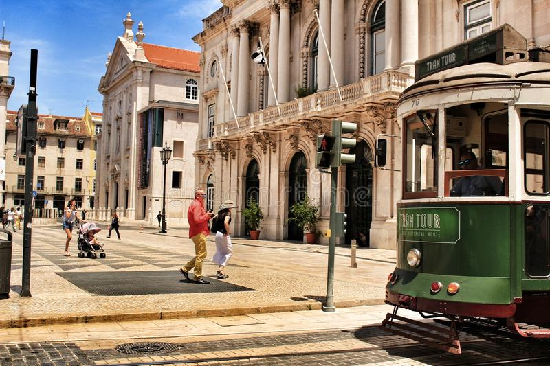 Colorful trams through the streets of Lisbon in Spring royalty free stock photography