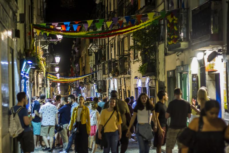 LISBON, PORTUGAL - JUNE 21, 2018: People in Lisbon street during popular saints festival stock images