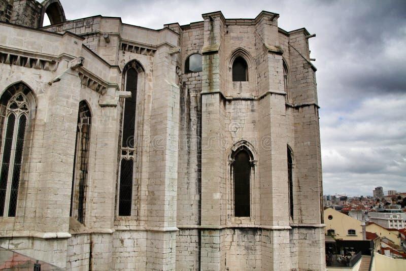 Arcades, pillars and facade of Do Carmo convent in Lisbon stock photography