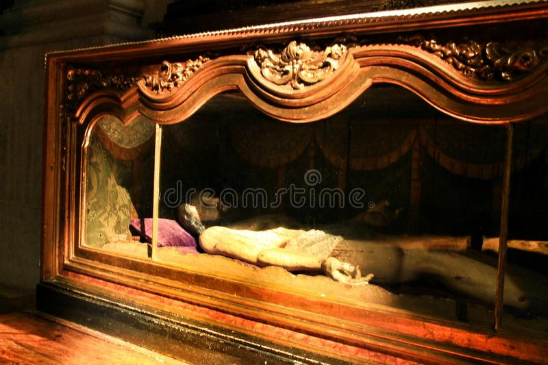 Jesus Christ carving wood prostrate in a church of Lisbon royalty free stock images
