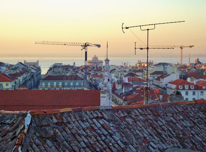 View over the rooftops to the river Tejo. Lisbon, Portugal. royalty free stock photo