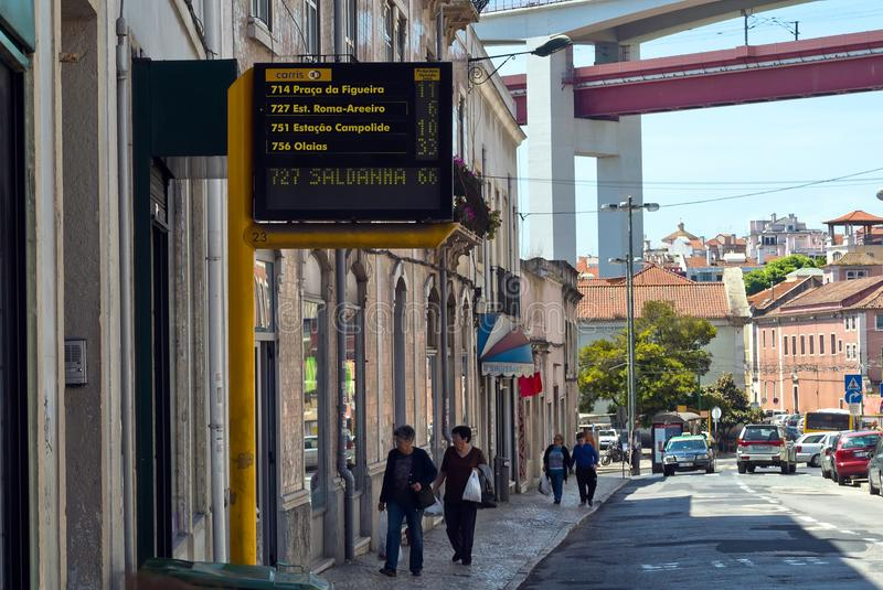 Lisbon, Portugal - May 4, 2013 Electronic timetable with estimated arrival time for buses on a street royalty free stock photo