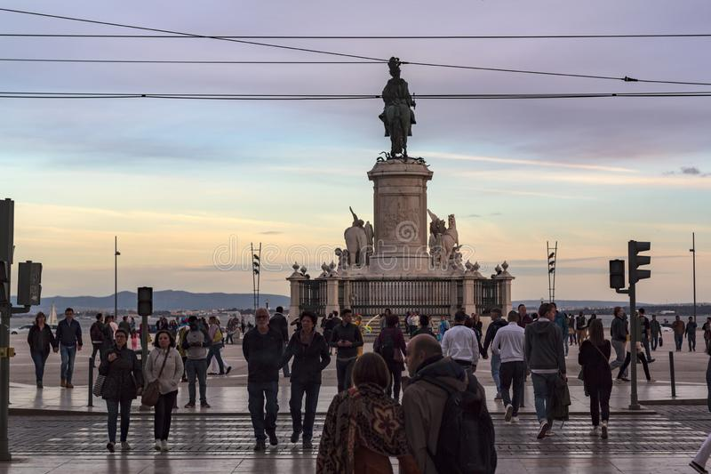 Local people and tourists walking in downtown Lisbon in the late afternoon stock photo