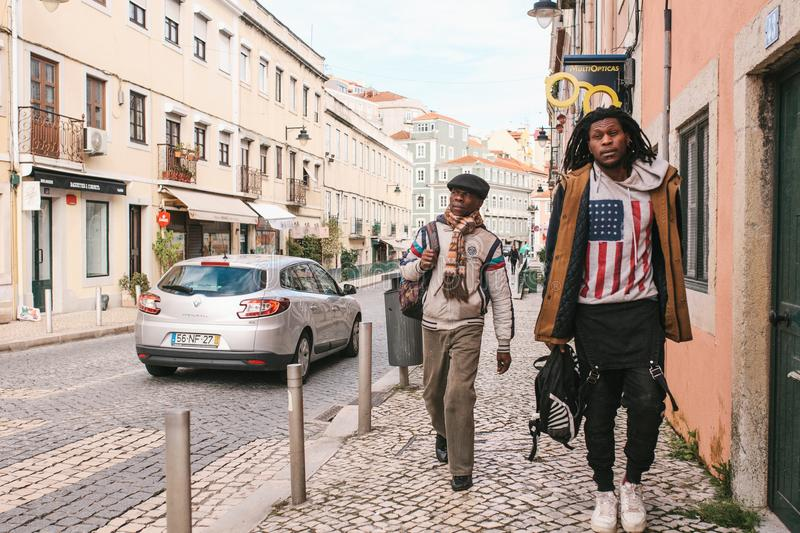 Lisbon, Portugal may 01, 2018: Street lifestyle. Migrants or refugees in Europe. Tourists or hipsters or the African stock image