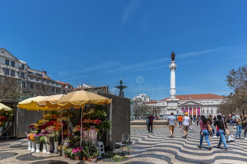 Lisbon, Portugal - May 9th 2018 - Tourists and Locals walking at the Rossio boulevard in downtown Lisbon, Portugal`s capital at a stock photo