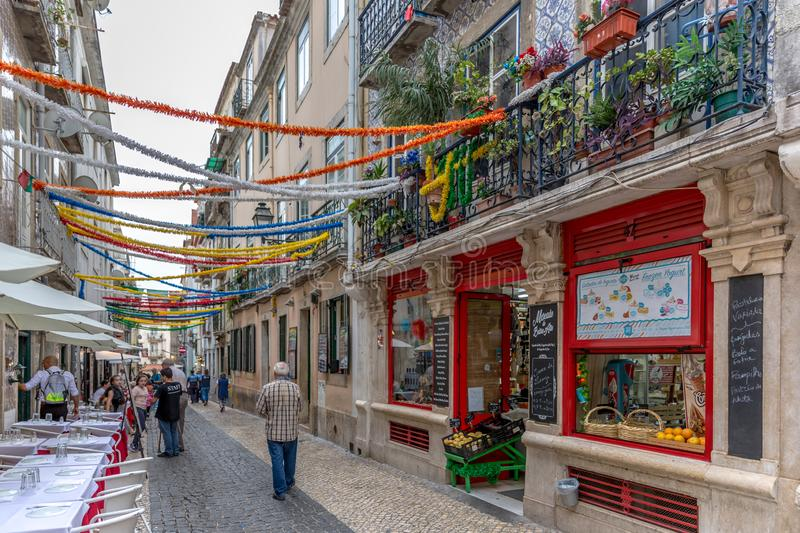 Lisbon, Portugal - May 9th 2018 - Tourists and locals walking in the streets of Chiado area in downtown Lisbon in Portugal royalty free stock photo