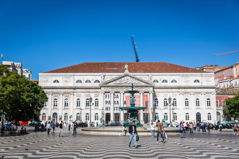 Lisbon, Portugal - May 9th 2018 - Tourists and locals walking in a traditional boulevard in Lisbon downtown in a blue sky day, Por stock photos