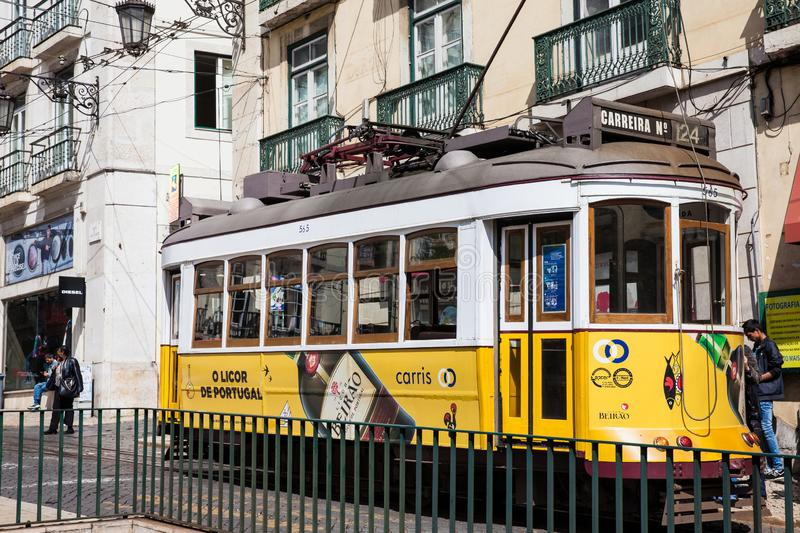 Traditional electric public transport called tram at the famous Luis de Camoes Square royalty free stock photo